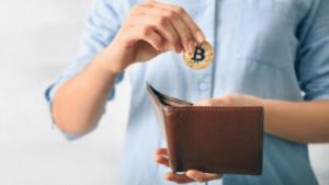 Man puts bitcoin into wallet